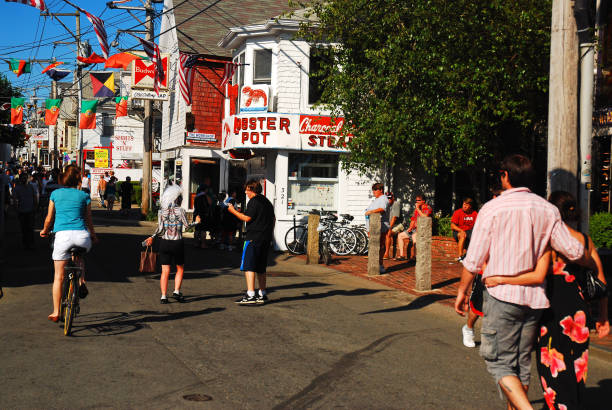 Busy Commercial Street, Provincetown, Cape Cod Provincetown, MA, USA July 5, 2009  Summer tourists flock to Provincetown, Massachusetts, a popular resort town on Cape Cod provincetown stock pictures, royalty-free photos & images
