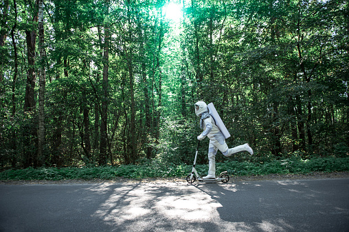 istock Busy cosmonaut having fun in forest 878620354