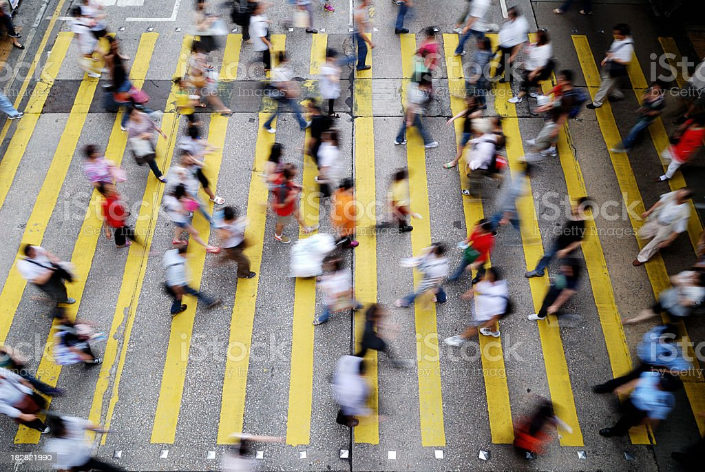Busy cross walk with a blur of people in Hong Kong royalty-free stock photo