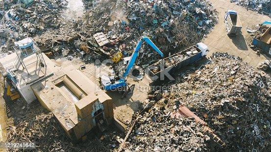 Heavy machinery working at scrapyard