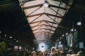High angle shot of the Queen Victoria Market in Australia. It is a busy summer day.