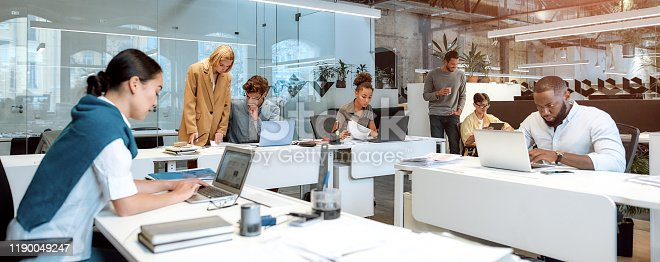Busy day. Group of multiracial business people working together in the creative co-working space. Team building concept. Office life. Web banner