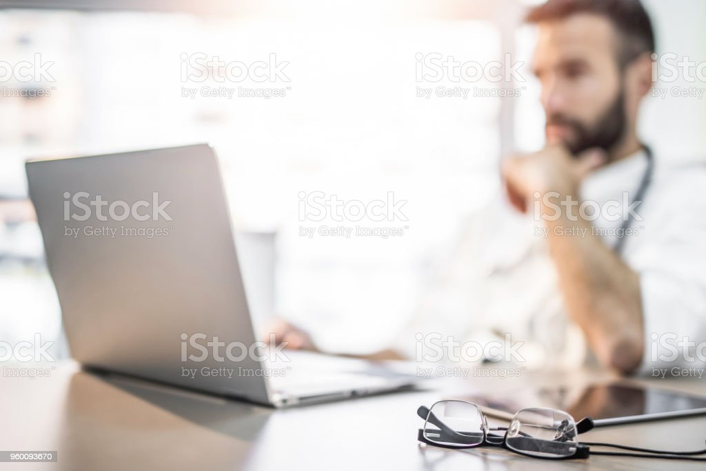 Busy doctor's desk. stock photo