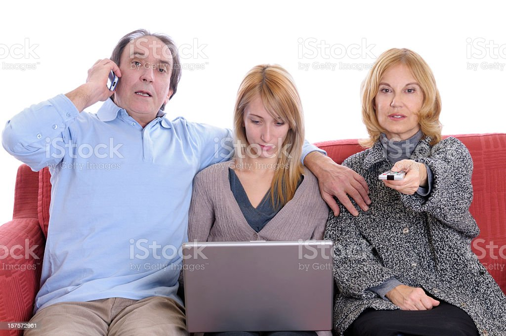 Busy Family on Red Sofà royalty-free stock photo