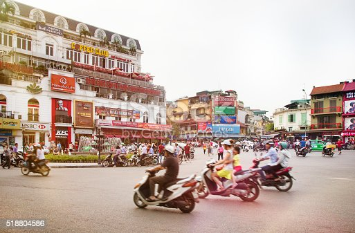 istock Busy Hanoi Fountain roundabout with traffic 518804586