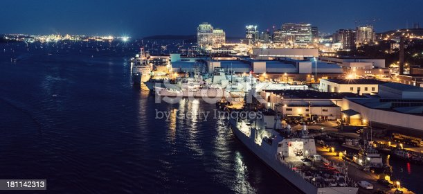 A panoramic view of Halifax Harbour and the city skyline viewed from the Angus L. MacDonald Bridge.  Light grain.