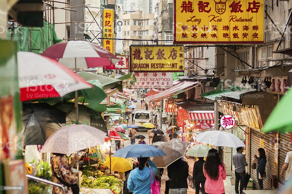 Busy Hong Kong Market on a Rainy Day stock photo
