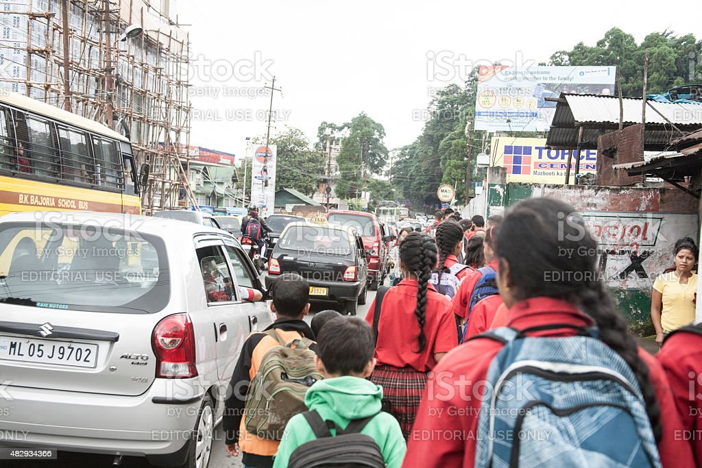 Busy India city street. Traffic, children walking to school. stock photo