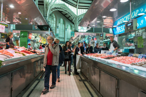 Busy indoor Central Market of Valencia, Spain stock photo