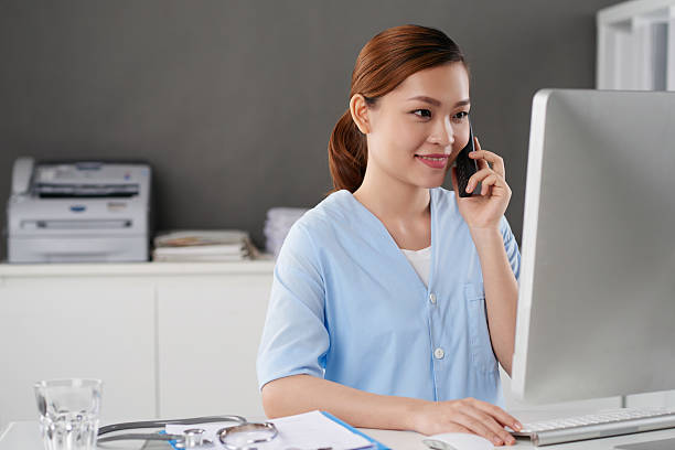 busy intern - nurse on phone stock photos and pictures