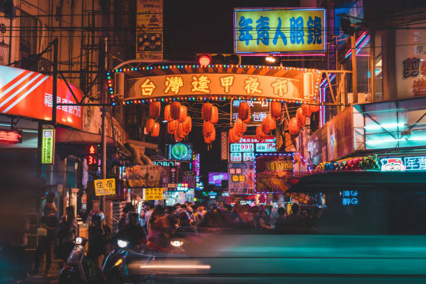 Busy junction at the street of Taichung Fengcia night market Busy junction at the street of Taichung Fengcia night market taiwan stock pictures, royalty-free photos & images