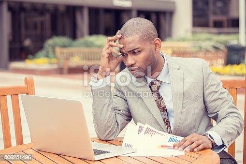 istock Busy man analyzing company financial report balance sheet statement 506251496