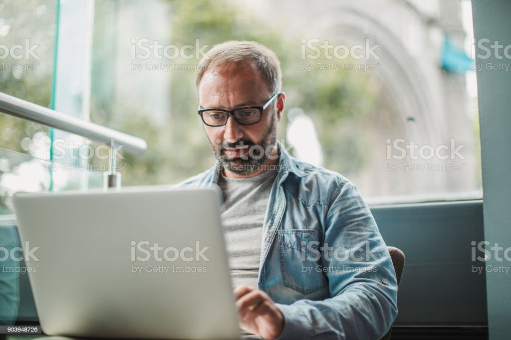 Busy man working on laptop stock photo