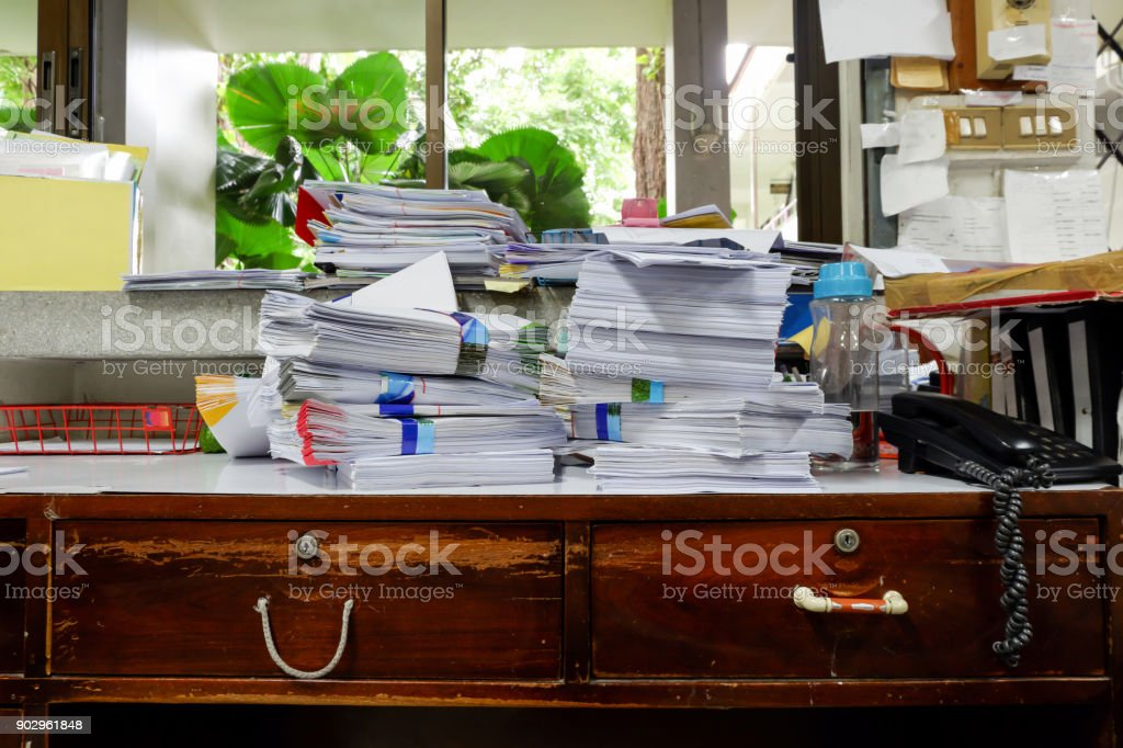 Busy, messy and cluttered workplace, full of documents stock photo