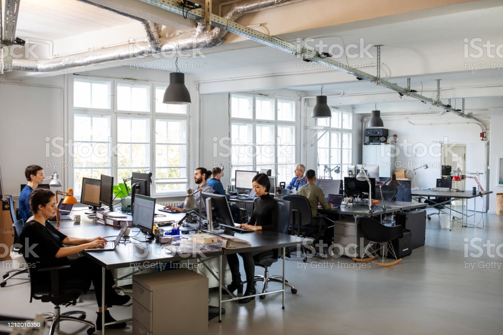 Busy modern open plan office with staff - Royalty-free Adult Stock Photo