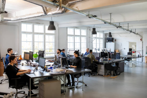 Busy modern open plan office with staff stock photo