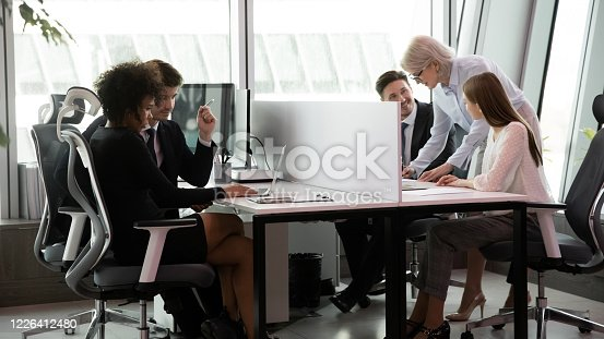 1090214584 istock photo Busy multiracial employees working in co-working open space 1226412480