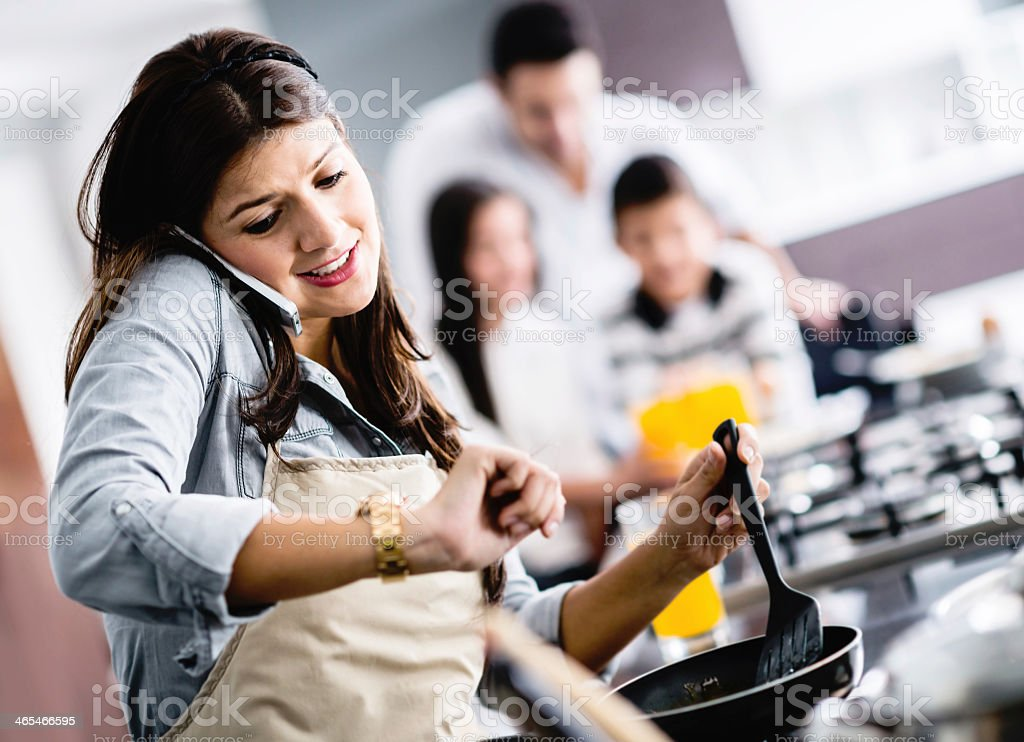 Busy mum cooking at home stock photo