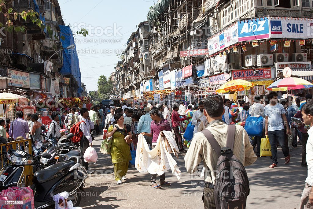 Busy Mumbai street corner at Crawford Market stock photo