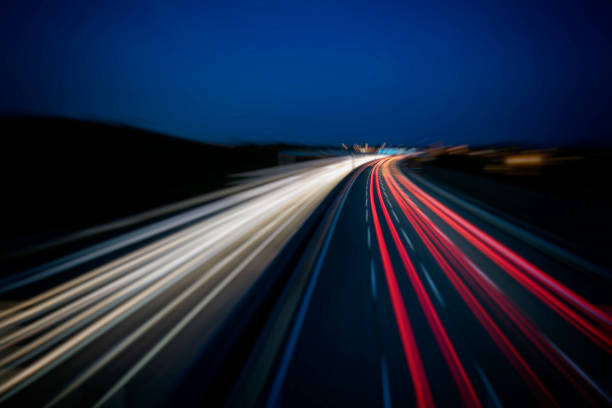 busy night highway traffic light trails from night highway traffic multiple lane highway stock pictures, royalty-free photos & images