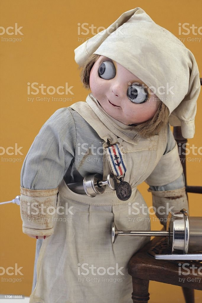 Busy nurse doll with syringes. stock photo