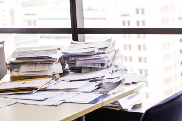 busy office with stack document on table. stock photo