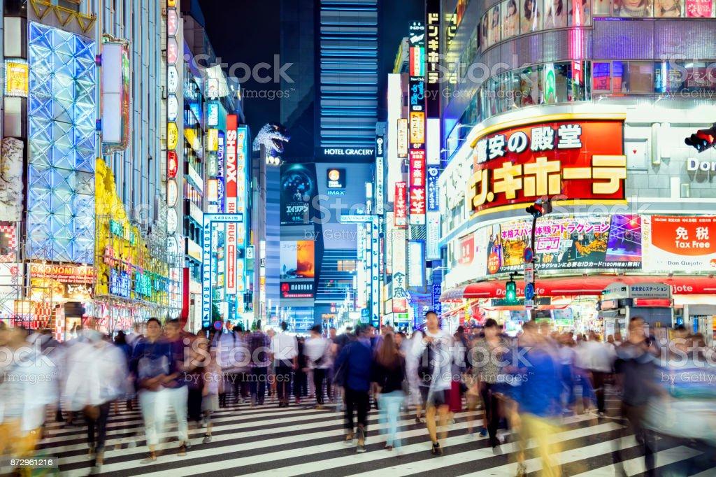 Busy Pedestrians Crossing Street in Tokyo, Japan stock photo