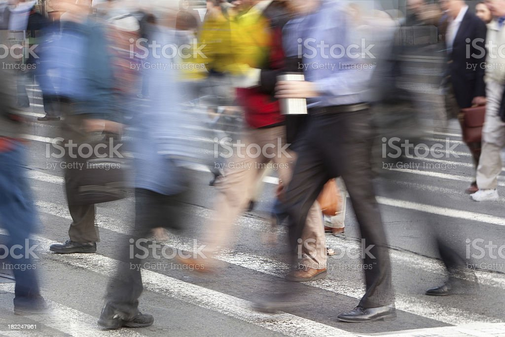 Busy people in a downtown crosswalk royalty-free stock photo