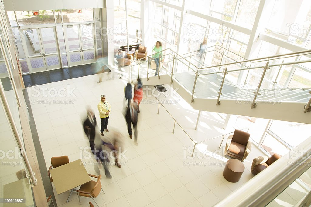 Busy people in business office, bank or shopping mall. stock photo