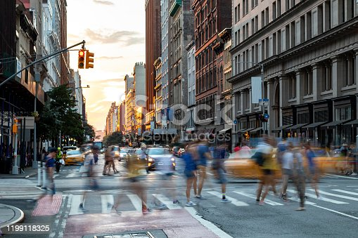 813211754 istock photo Busy people walk across the crowded intersection on 23rd Street and Fifth Avenue, New York City 1199118325