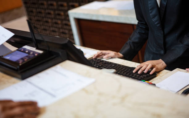 Busy receptionist stock photo