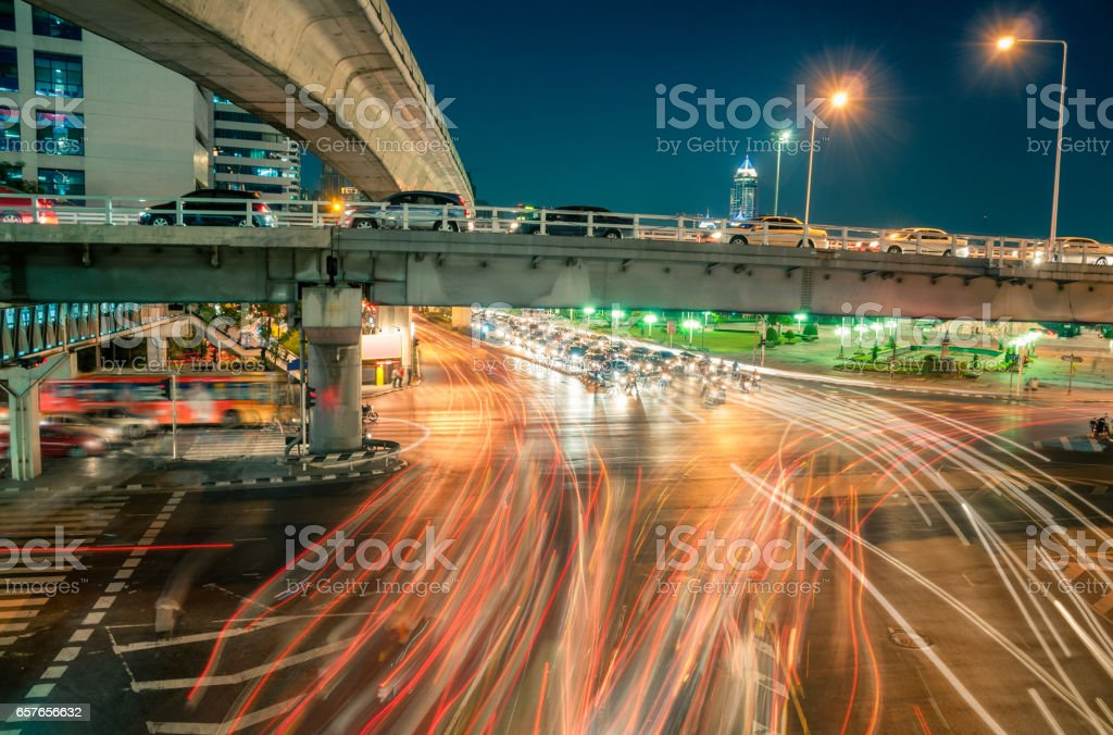 Busy Road Intersection At Night In The Silom Area Of Bangkok stock photo