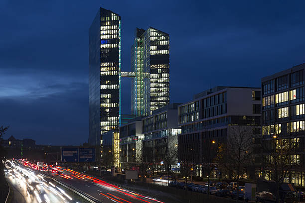busy road with office building in munich, germany - arbeit in münchen stock-fotos und bilder