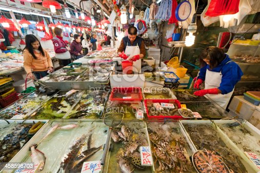 istock Busy seafood fish market Chinese shoppers fishmongers Hong Kong China 458598703