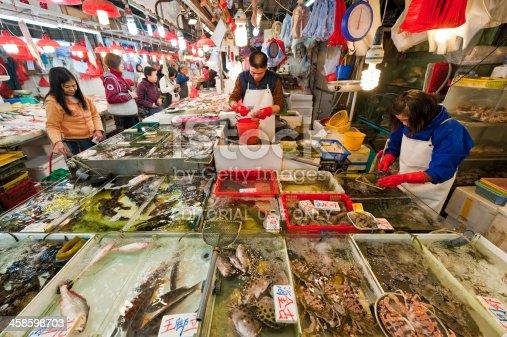 istock Busy seafood fish market Chinese shoppers fishmongers Hong Kong China 458598703