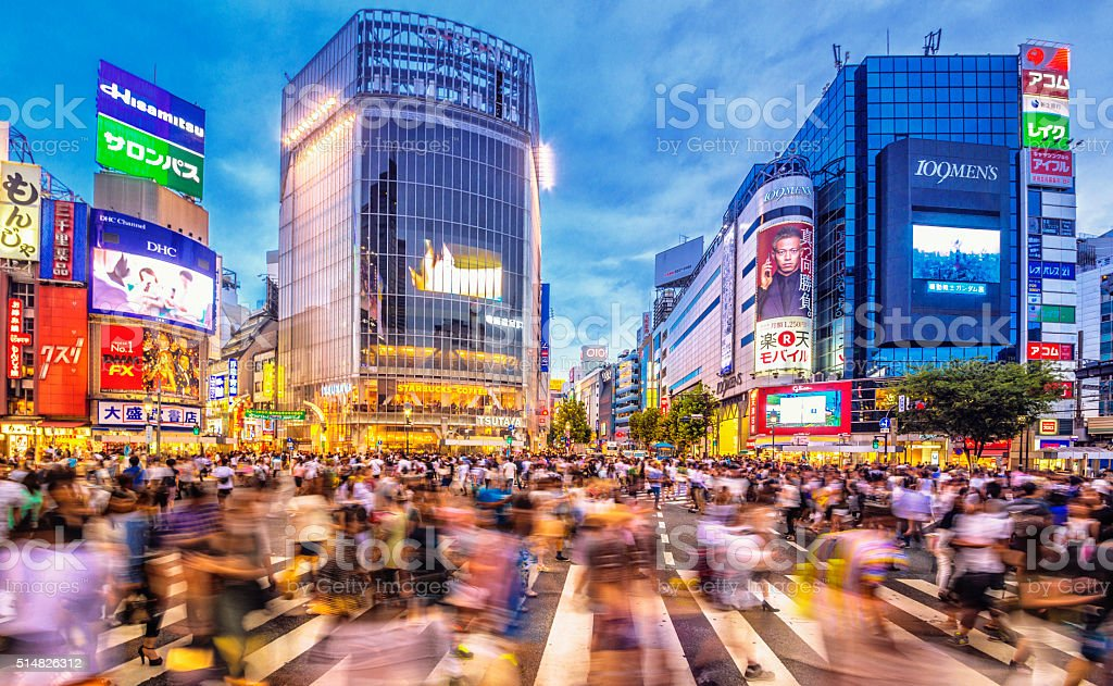 Busy Shibuya Crossing in Tokyo at dusk stock photo