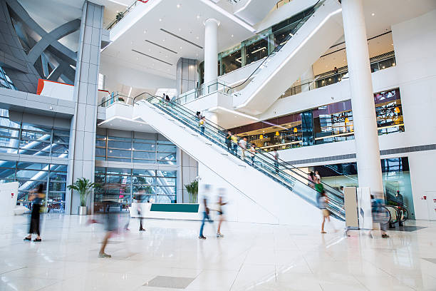 busy shopping mall - shopping mall stock photos and pictures