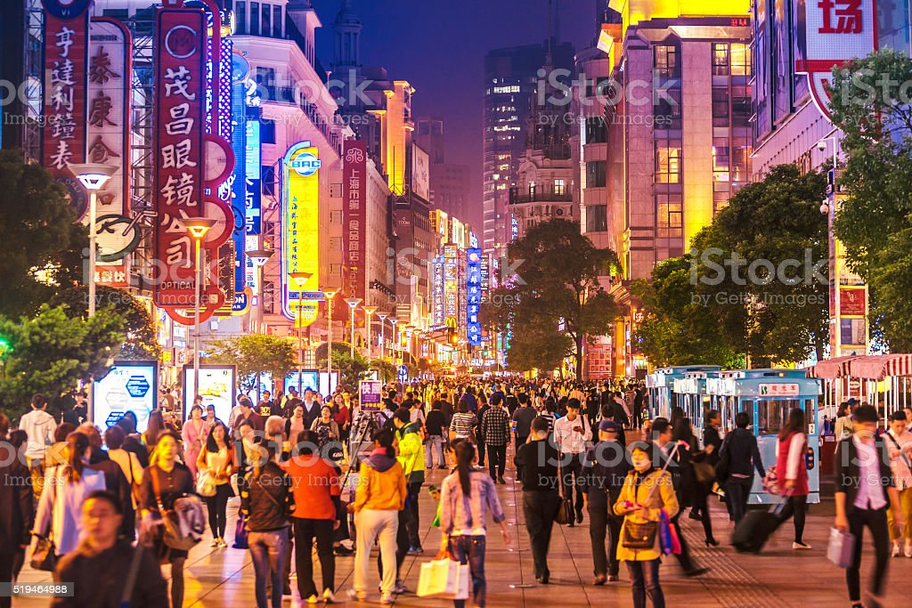 busy Shoppping Street in Shanghai, China at night stock photo