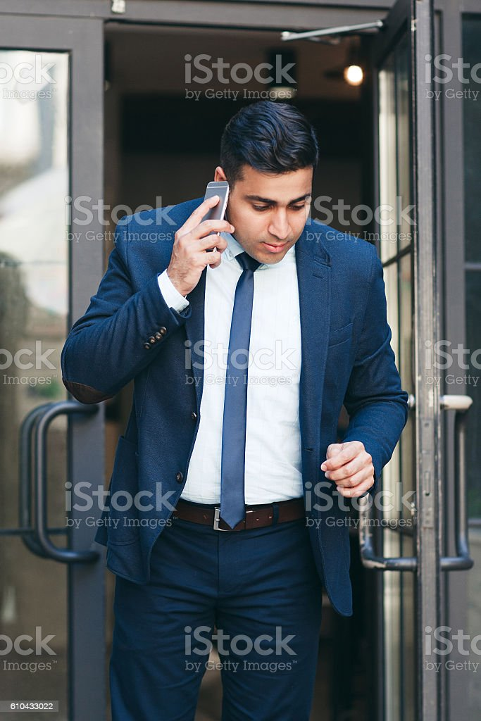 Busy stock market trader in a hurry stock photo