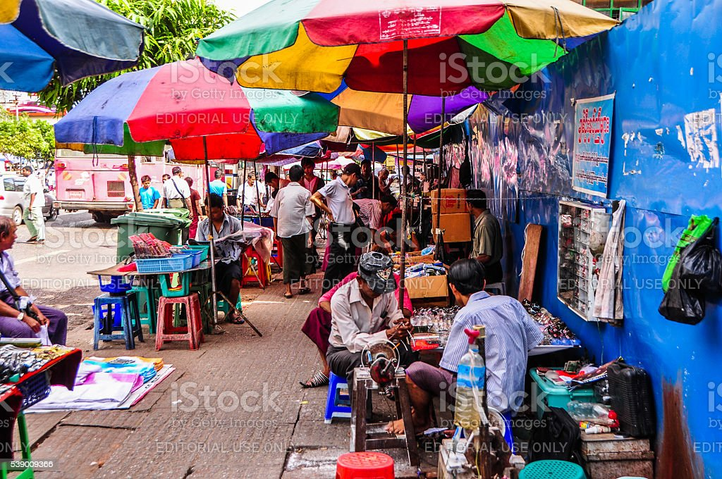 Busy street and stalls in Yangon city stock photo
