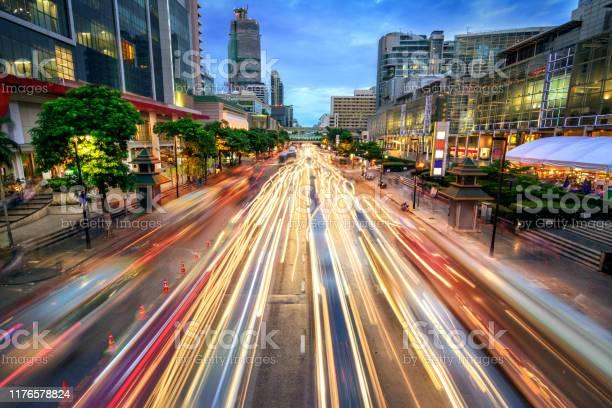 Photo of Busy street at dusk, full of car light streaks