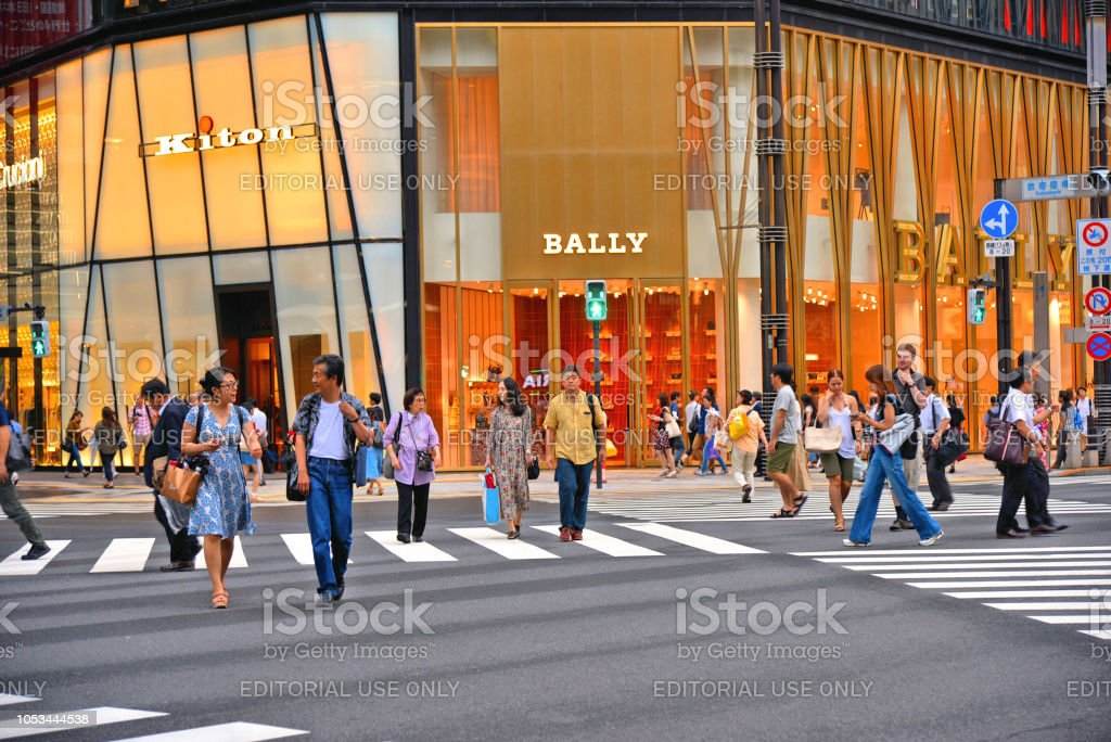 . Busy street full of people and modern architecture and buildings...