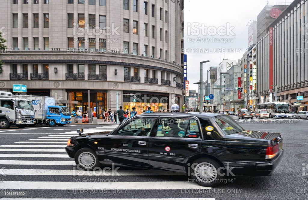 . Busy street full of people, cars and modern architecture and...