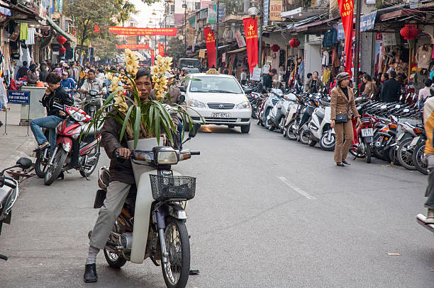 busy street in hanoi's old quarter - motorbike, umbrella stock photos and pictures