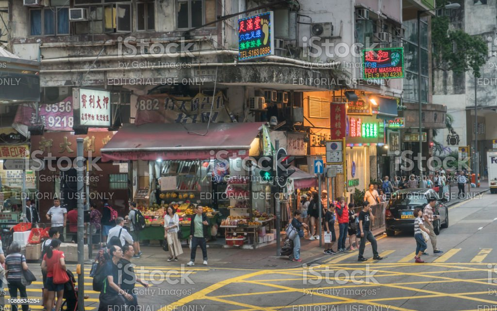Hong Kong. Kowloon District. People and traffic on famous Nathan Road