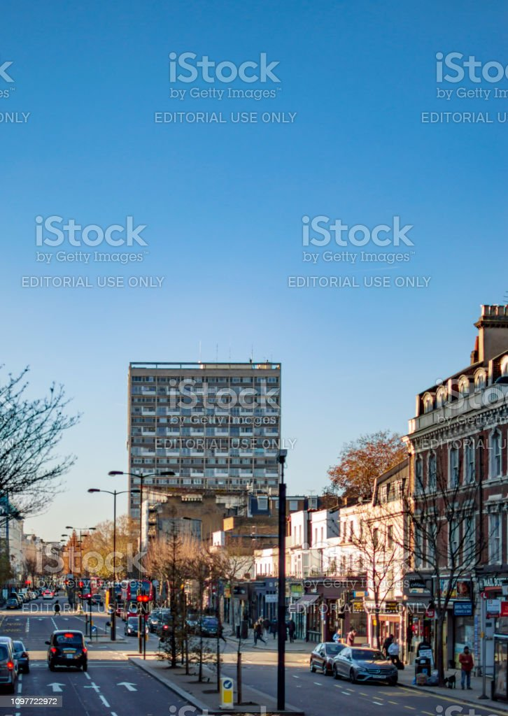 A busy street in london with its vehicles and buildings. - Image