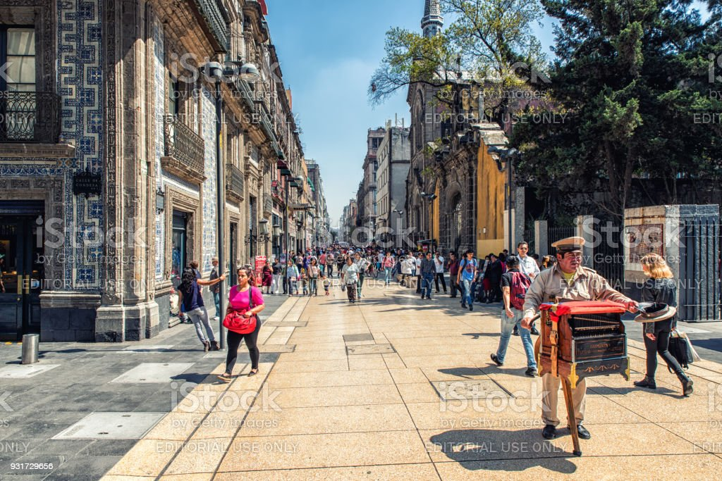 Busy Street in Mexico City Mexico City, Mexico - February 15, 2018: The Historic District is always busy, but during the festivities of Day of the dead it's even more crowded. There are a lot of activities going on. Capital Cities Stock Photo