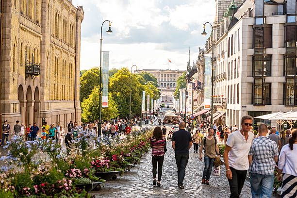 Busy street in Oslo city center, Norway Oslo, Norway - July 20, 2015: Karl Johans gate, Oslo. People walking on famous street in city center, sightseeing and shopping oslo stock pictures, royalty-free photos & images