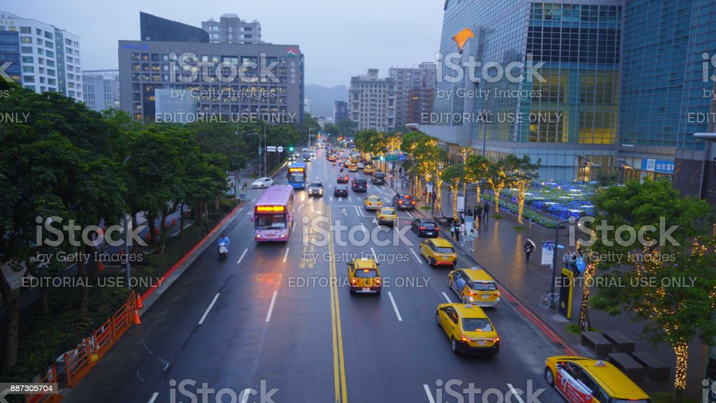 TAIPEI, TAIWAN - June 26: A busy street in Xinyi financial district of Taipei city in the late evening, Jne 25, 2017 in Taipei, stock photo