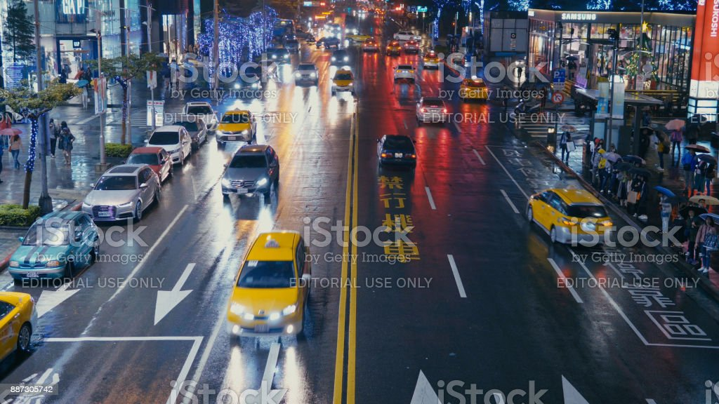 A busy street in Xinyi financial district of Taipei city in the late...